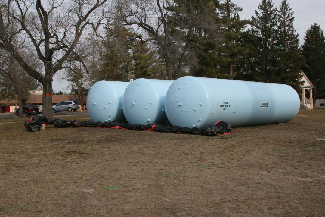 Click to enlarge an image with captions & Temporary Water Storage - Garrison Enterprise Inc.